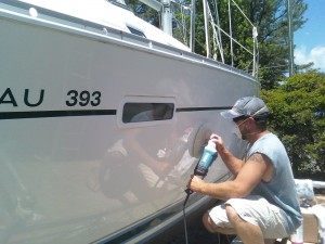 Image of a boat worker-buffing-gelcoat
