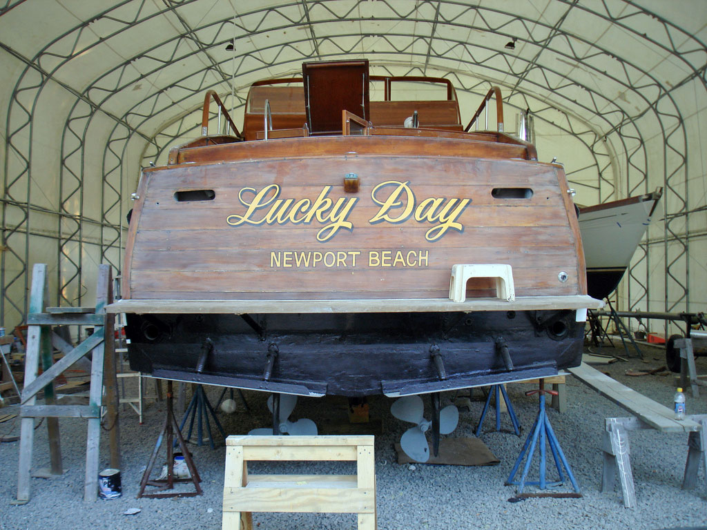 WOODEN MOTOR BOAT INTHE INDOOR FACILITY FOR SERVICE